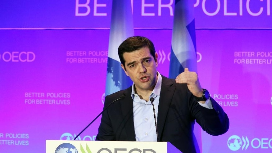 Greek prime minister Alexis Tsipras delivers his speech during a conference at the OECD headquarter in Paris, Thursday March 12, 2015. Greek Prime Minister Alexis Tsipras says his government will continue to repay its creditors even if it doesn't get part of a rescue loan pending the outcome of current bailout talks. (AP Photo/Remy de la Mauviniere)