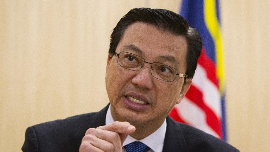 FILE - In this March 7, 2015 file photo, Malaysian Transport Minister Liow Tiong Lai gestures during an interview ahead of the one-year anniversary of the disappearance of the Malaysia Airlines Flight MH370 in Putrajaya, Malaysia. Liow on Thursday, March 12, vowed to take stern action against an air traffic control supervisor if it is confirmed that he was asleep on the job when the Boeing 777 disappeared a year ago. (AP Photo/Joshua Paul, File)