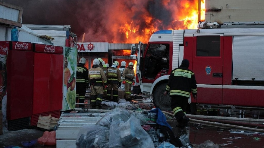 March 11, 2015: Firefighters extinguish a fire at a shopping mall in Kazan,  450 miles east of Moscow, Russia. One of Kazan's largest shopping malls and adjoining kiosks in the city's Kirov district have been heavily damaged by the blaze that raged for hours on Wednesday.
