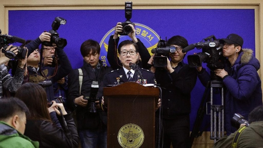 Seoul metropolitan police official Kim Choul-joon, center, speaks during a press conference at Jongro police station in Seoul, South Korea, Friday, March 13, 2015. South Korean police said Friday that an anti-U.S. arrested last week for allegedly stabbing U.S. Ambassador Mark Lippert had intended to kill the envoy to highlight his protest against ongoing U.S.-South Korean military drills. (Ahn Young-joon)