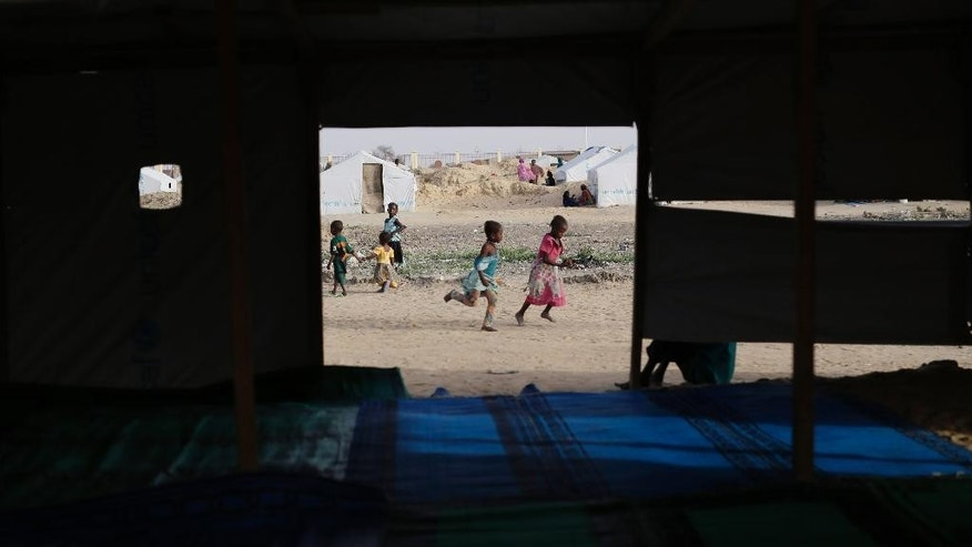 Children play by the makeshift mosque in the Zafaye refugee camp, some 15 kms (10 miles) from downtown N'djamena, Chad, Wednesday March 11, 2015. Over 5000 refugees of Chadian descent who fled the fighting in Central African Republic have been living in the camp for over a year.  Chad is also hosting thousands of refugees fleeing the current Boko Haram fighting in Nigeria. (AP Photo/Jerome Delay)