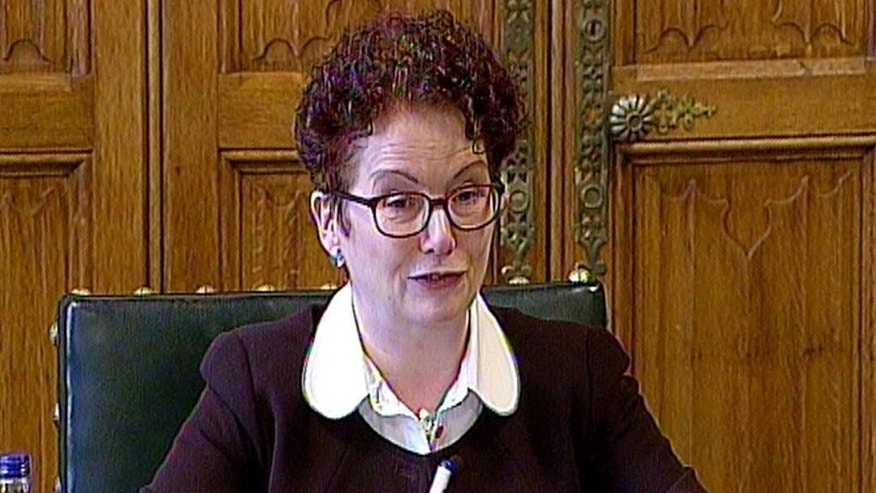 "In this image from TV, British Member of Parliament Hazel Blears reports on the Intelligence and Security Committee of Parliament report into Privacy and Security, at the House of Commons in London, Thursday March 12, 2015. United Kingdom spies intercept Britons' online communications in bulk and keep personal data on large numbers of British citizens, but not enough to amount to blanket surveillance or ""reading everyone's emails,"" committee member Blears revealed Thursday. (AP Photo / Parliament TV via PA) UNITED KINGDOM OUT - NO SALES - NO ARCHIVE"
