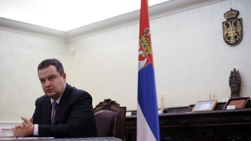"Serbia's Foreign Minister and Organization for Security and Co-operation in Europe (OSCE) Chairperson-in-office for 2015 Ivica Dacic speaks during an interview with The Associated Press, in Belgrade, Serbia, Friday, March 13, 2015. Dacic told The Associated Press in an interview Friday that Serbia's relations with Slavic ally Russia ""most certainly are not a handicap"" when it comes to remaining unbiased in the Ukrainian crisis. (AP Photo/Darko Vojinovic)"