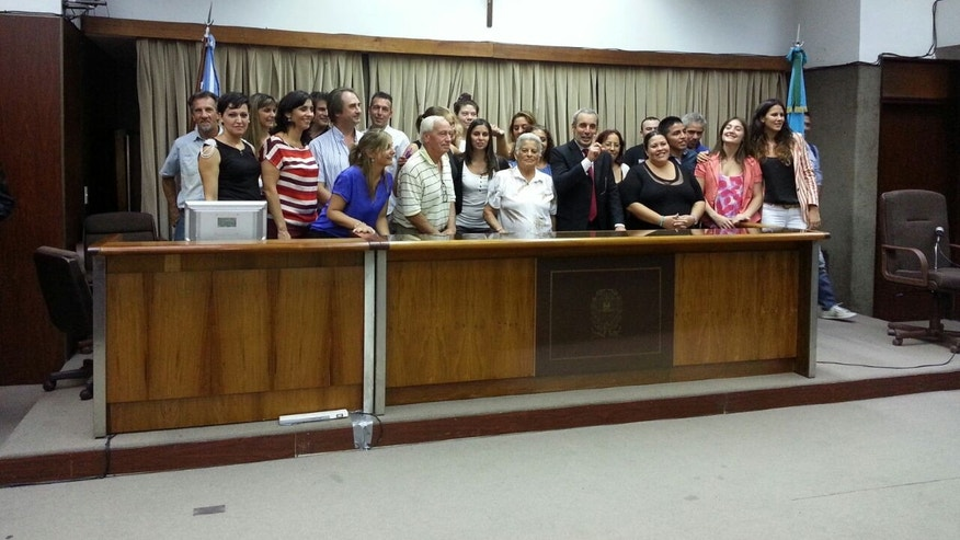 The judge and jury pose for a photo after taking part in the first trial-by-jury in the history of Buenos Aires province in Argentina.
