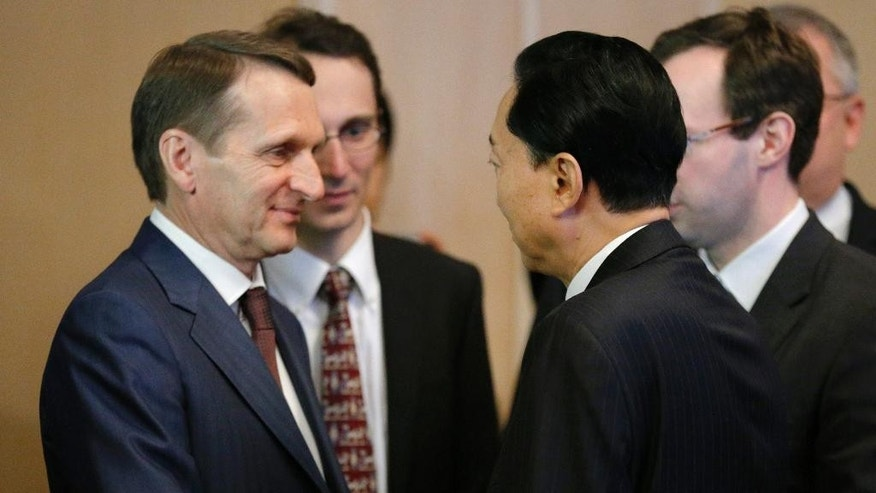Russian State Duma speaker Sergei Naryshkin, left, shakes hands with former Japanese Prime Minister Yukio Hatayama prior to their talks in Moscow, Russia, Friday, March 13, 2015. Yukio Hatayama visited Crimea on Tuesday March 10. (AP Photo/Alexander Zemlianichenko)