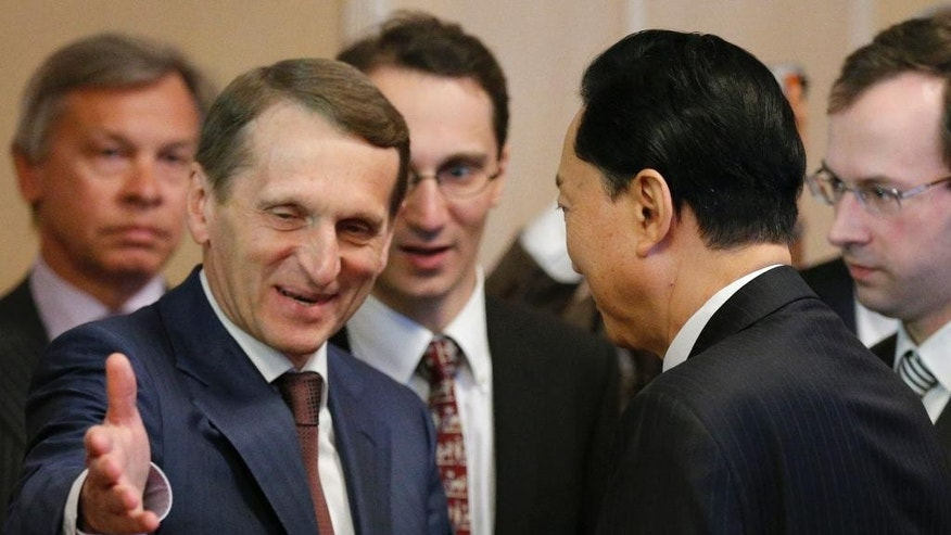 Russian State Duma speaker Sergei Naryshkin, left, welcomes former Japanese Prime Minister Yukio Hatayama prior their talks in Moscow, Russia, Friday, March 13, 2015. Yukio Hatayama visited Crimea on Tuesday March 10. (AP Photo/Alexander Zemlianichenko)