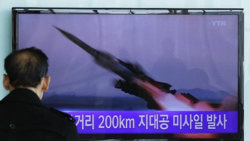 "A South Korean man watches a TV news program showing the file footage of the missile launch conducted by North Korea, at Seoul Railway Station in Seoul, South Korea, Friday, March 13, 2015. South Korea says North Korea has test fired seven missiles into the sea. A South Korean defense ministry official said Friday that the surface-to-air missiles launched from North Korea late Thursday flew into waters off the eastern coast. The writing on the screen reads: ""Launched 200 kilometers missile."" (AP Photo/Ahn Young-joon)"