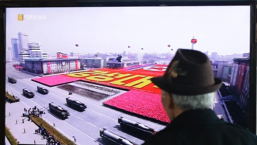 A South Korean man watches a TV news program showing the file footage of the North Korean missiles on a military parade at Seoul Railway Station in Seoul, South Korea, Friday, March 13, 2015. South Korea says North Korea has test fired seven missiles into the sea. A South Korean defense ministry official said Friday that the surface-to-air missiles launched from North Korea late Thursday flew into waters off the eastern coast. (AP Photo/Ahn Young-joon)