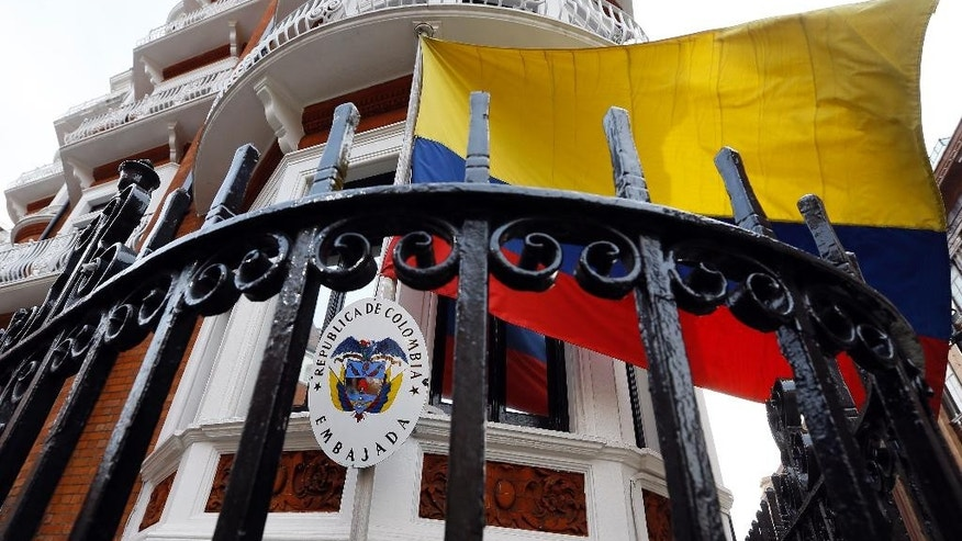 The flag flies outside of the Ecuadorean embassy in London, Friday, March 13, 2015. Swedish prosecutors on Friday offered to travel to London to question WikiLeaks founder Julian Assange, who has been living at the Ecuadorean embassy in London since 2012, potentially breaking a stalemate in an almost five-year-old investigation into alleged sex crimes, (AP Photo/Kirsty Wigglesworth)