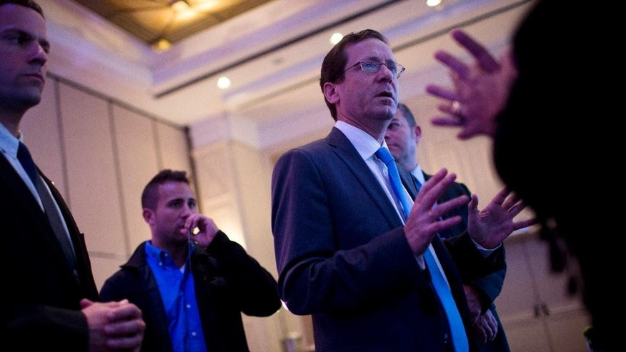 File - In this Wednesday, March 11, 2015 file photo, Isaac Herzog, leader of the Zionist Union party, attends a business conference in Tel Aviv. Polls show that Prime Minister Netanyahu's nationalist Likud Party is running slightly behind the Isaac Herzog's Labor Party, rebranded the Zionist Union in a bid for nationalist votes. (AP Photo/Oded Balilty, File)