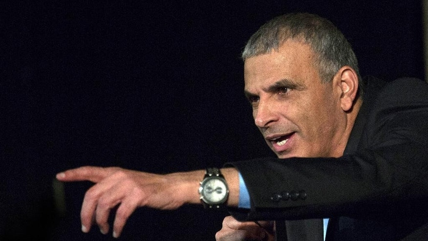 In this photo taken Tuesday, Feb. 24, 2015, Moshe Kahlon speaks during a debate hosted by the Israel Women's Network in Tel Aviv. Kahlon leads a non-aligned Kulanu party at the upcoming Israeli elections. Kahlon is a working-class Likud breakaway of Libyan Jewish descent who became popular for reducing mobile phone costs while serving in previous governments. (AP Photo/Tsafrir Abayov)
