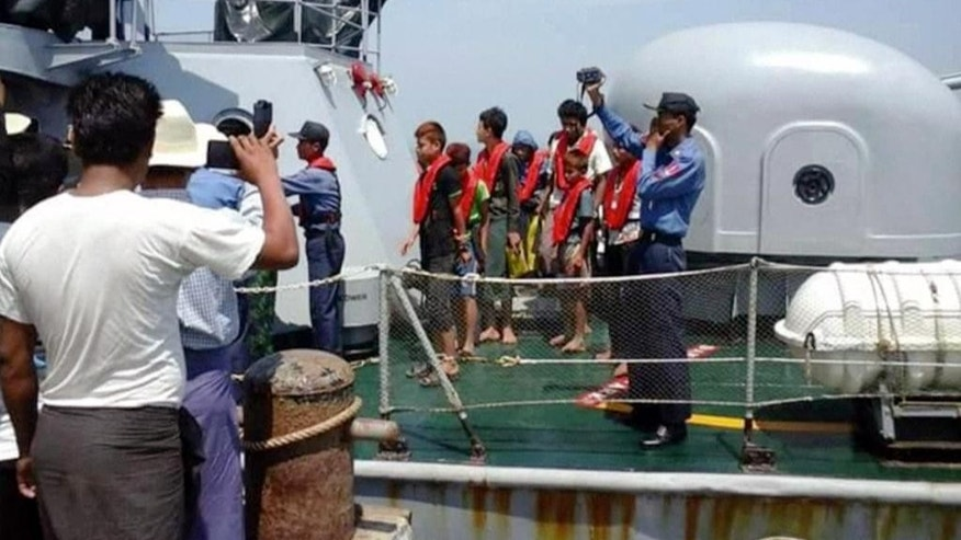 This image provided by DVB shows officials on a rescue boat near Kyauk Phyu port, Myanmar, on Saturday, March 14, 2015. A crowded double-decker ferry capsized in northwestern Myanmar after being slammed by huge waves, killing at least 21 people with nearly 50 others missing, officials said Saturday. (AP Photo/DVB) MANDATORY CREDIT