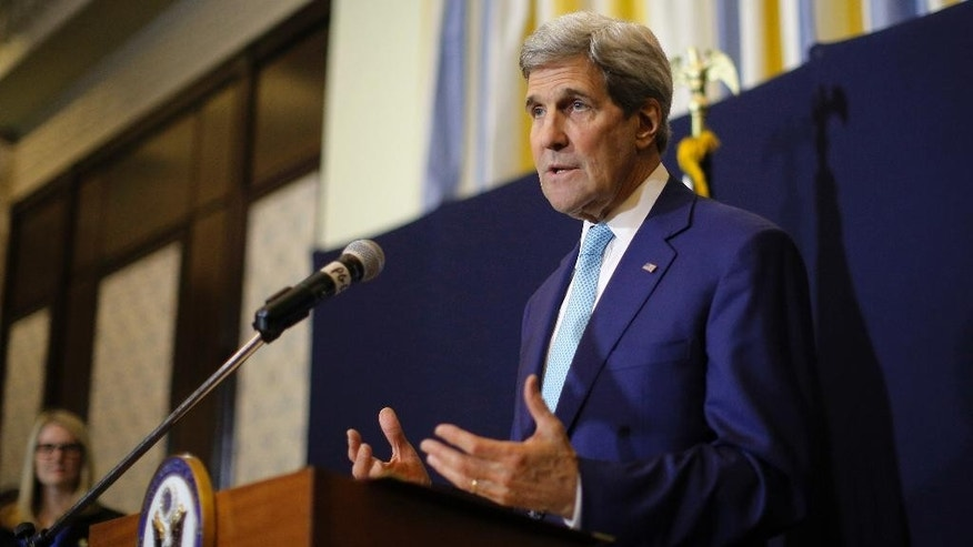 "U.S. Secretary of State John Kerry speaks at a news conference in Sharm el-Sheikh, Egypt, Saturday, March 14, 2015. Kerry said he's returning to nuclear negotiations with Iran with ""important gaps"" standing in the way of a deal. He spoke Saturday in the Egyptian resort, where he attended an economic conference. (AP Photo/Brian Snyder, Pool)"