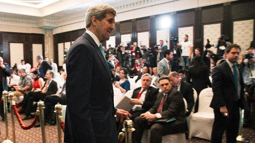 "U.S. Secretary of State John Kerry leaves a news conference in Sharm el-Sheikh, Egypt, Saturday, March 14, 2015. Kerry said he's returning to nuclear negotiations with Iran with ""important gaps"" standing in the way of a deal. He spoke Saturday in the Egyptian resort, where he attended an economic conference. (AP Photo/Brian Snyder, Pool)"