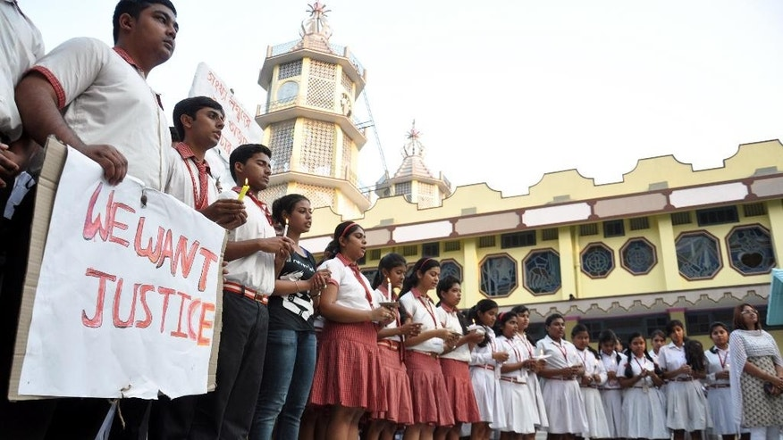 Students of Convent of Jesus and Mary School participate in a protest against the gang rape of a nun in her 70s by a group of bandits when she tried to prevent them from robbing the Christian missionary school in Begopara, about 80 kilometers (50 miles) northeast of Kolkata, the capital of West Bengal state, Saturday, March 14, 2015. The nun was hospitalized in serious condition after the attack, which was committed by seven or eight men. The woman who was attacked is either 71 or 72 and is the oldest nun at the school, a police officer said. (AP Photo/Pranab Debnath)
