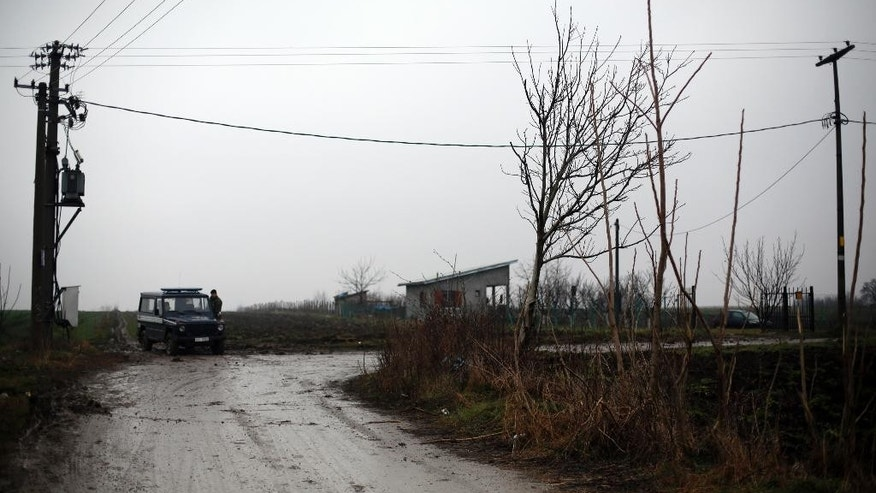 Serbian army soldiers guard the site of a helicopter crash on the outskirts of Belgrade, Serbia, Saturday, March 14, 2015. A Serbian military helicopter crashed near Belgrade while evacuating a sick baby from south of the country, killing all seven people on board, officials said Saturday. The defense ministry said no one survived the crash late Friday night near Belgrade's international airport, some 30 kilometers (18 miles) west of the capital. (AP Photo/Darko Vojinovic)
