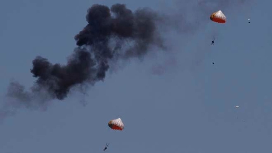 March 15, 2015: Pilots from Indonesias Jupiter aerobatics team are ejected after a mid-air collision during a practice session at the Langkawi International Maritime and Aerospace (LIMA) exhibition in Langkawi, Malaysia. (AP)