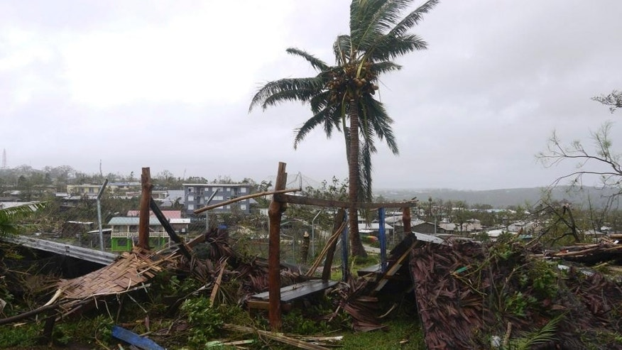 In this March 14, 2015, photo provided by World Vision debris is strewn around a lone tree in Port Vila, Vanuatu, after Cyclone Pamripped through the tiny South Pacific archipelago. Packing winds of 270 kilometers (168 miles) per hour, Cyclone Pam tore through Vanuatu early Saturday, leaving a trail of destruction. (AP Photo/World Vision) EDITORIAL USE ONLY, NO SALES
