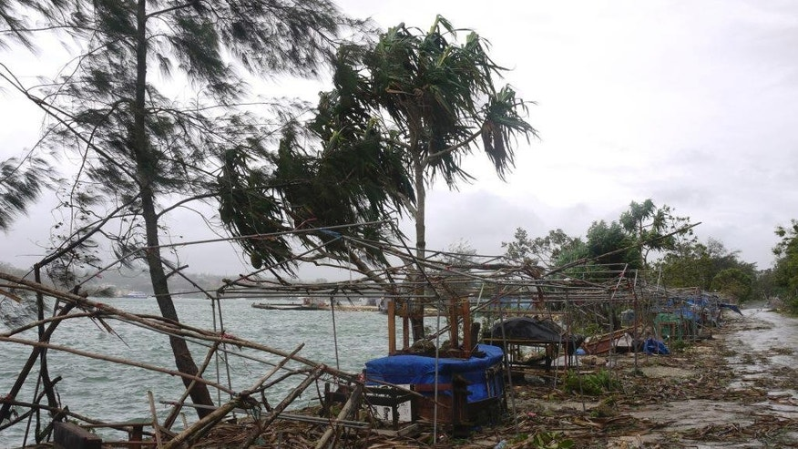 In this March 14, 2015, photo provided by World Vision,  debris is scattered along the coast in Port Vila Vanuatu, after Cyclone Pam ripped through the tiny South Pacific archipelago. Packing winds of 270 kilometers (168 miles) per hour, Cyclone Pam tore through Vanuatu early Saturday, leaving a trail of destruction. (AP Photo/World Vision) EDITORIAL USE ONLY, NO SALES