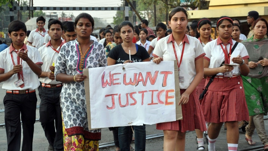 March 14, 2015: Students of Convent of Jesus and Mary School participate in a protest against the gang rape of a nun in her 70s by a group of bandits when she tried to prevent them from robbing the Christian missionary school in Begopara,