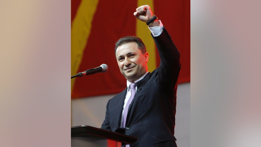 "Macedonian Prime Minister and leader of the ruling center-right VMRO-DPMNE party Nikola Gruevski raises his fist while speaking to  supporters at the party's gathering in capital Skopje, Macedonia, Sunday, March 15, 2015. Prime Minister Gruevski said before thousands of supporters at the party's gathering on Sunday that he would not resign, adding that oppositional leader Zoran Zaev is working for ""foreign service interests"", by publishing illegally wire-taped recordings. (AP Photo/Boris Grdanoski)"