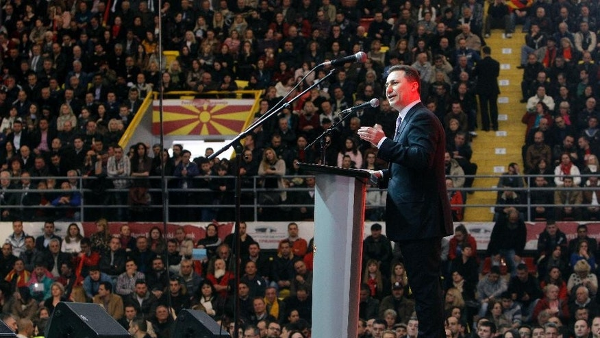 "Macedonian Prime Minister and leader of the ruling center-right VMRO-DPMNE party Nikola Gruevski speaks to supporters at the party's gathering in capital Skopje, Macedonia, Sunday, March 15, 2015. Prime Minister Gruevski has denounced on Sunday the oppositional accusations about government official's wrongdoings with wire-tapping scandal, accusing the left-wing head of the main oppositional Social-democrats Zoran Zaev of being involved into activities for ""destabilization of the country"". (AP Photo/Boris Grdanoski)"
