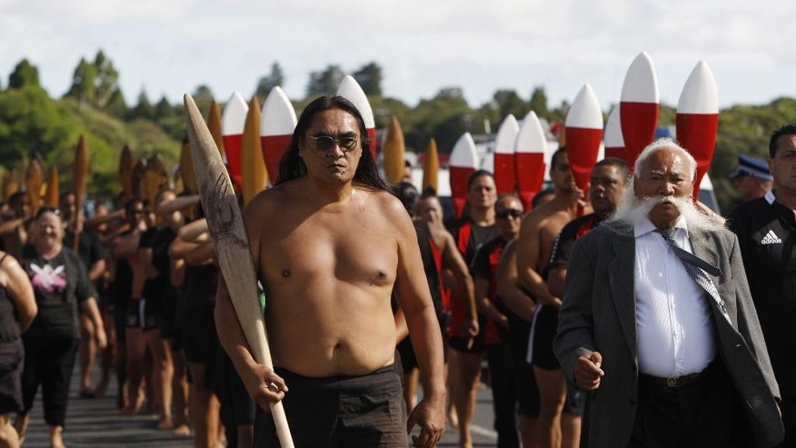 In this Feb. 5, 2015 photo, Maori canoeists march down the street in Waitangi, New Zealand, to mark the 175th anniversary of the signing of the country's founding document, the Treaty of Waitangi. Financial settlements made to Maori tribes under the provisions of the treaty are helping transform them into major economic players and are contributing to a broader cultural renaissance and improved prospects for Maori. (AP Photo/Nick Perry)