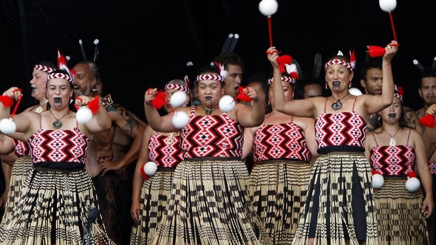 "In this Feb. 6, 2015 photo, dancers twirl white ""poi"" balls as part of an indigenous Maori performance, in Waitangi, New Zealand, to mark the 175th anniversary of the signing of the country's founding document, the Treaty of Waitangi. Financial settlements made to Maori tribes under the provisions of the treaty are helping transform them into major economic players and are contributing to a broader cultural renaissance and improved prospects for Maori. (AP Photo/Nick Perry)"