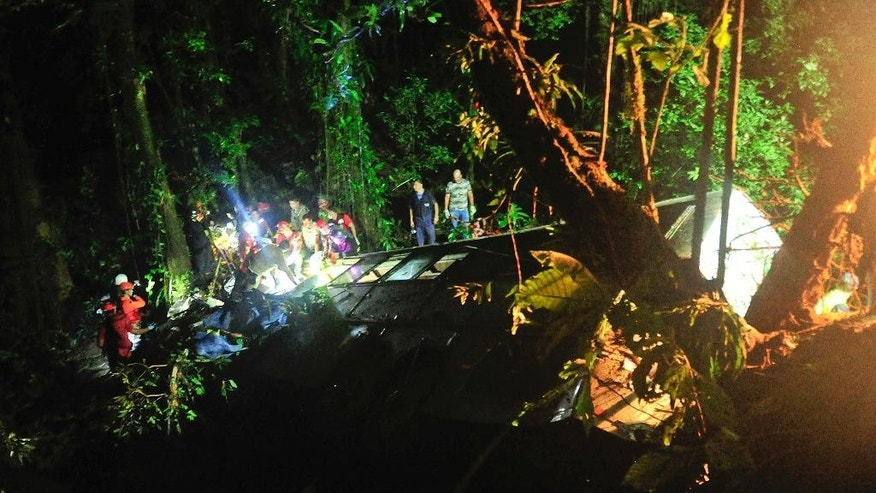 Rescue personnel work at the site where a tourist bus crashed killing at least 49 people, according to the the Santa Catarina State security secretary, near the city of Joinville, southern state of Santa Catarina, Brazil, Saturday, March 14, 2015. (AP Photo/Salmo Duarte, Agence RBS)