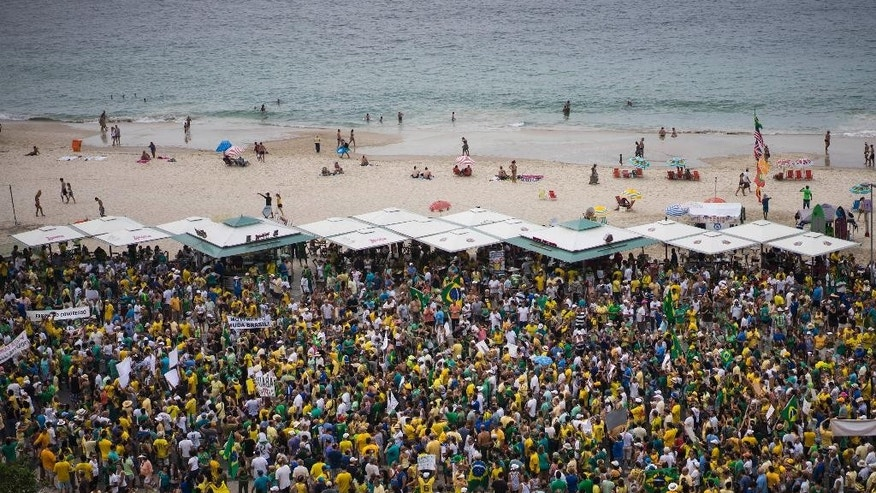People gather in Copacabana beach during a protest against Brazil's President Dilma Rousseff in Rio de Janeiro, Brazil, Sunday, March 15, 2015. Protests have been called for across Brazil to demonstrate against President Dilma Rousseff, whose popularity has never been lower as she faces a sputtering economy and a massive corruption scandal. (AP Photo/Felipe Dana)