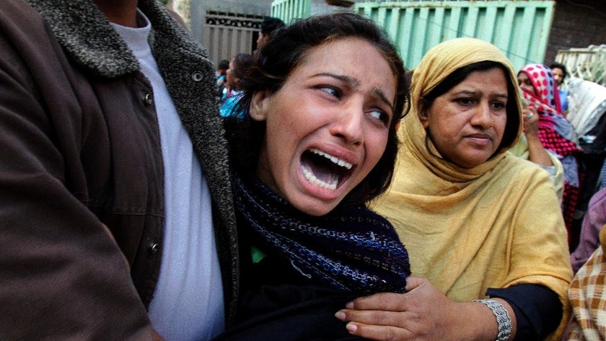 A Pakistani Christian woman mourns over a family member who was killed from a suicide bombing attack near two churches in Lahore, Pakistan, Sunday, March 15, 2015. Suicide bombers exploded themselves near two churches in the eastern city of Lahore on Sunday as worshippers were gathered inside, killing at least a dozen people, officials said, in the latest attack against religious minorities in the country. (AP Photo/K.M. Chaudary)