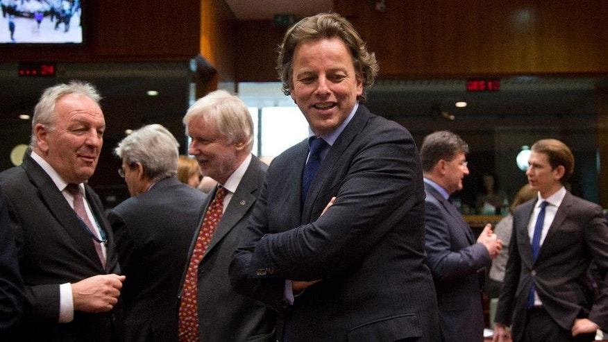 Dutch Foreign Minister Bert Koenders, center, waits for the start of a meeting of EU foreign ministers at the EU Council building in Brussels on Monday, March 16, 2015. The European Union is debating ways to back peace talks in Libya but is unlikely to launch any security mission until stability returns to the conflict-torn country. (AP Photo/Virginia Mayo)