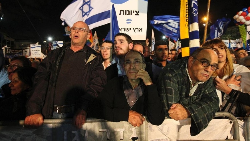 Supporters of Israeli Prime Minister Benjamin Netanyahu gather during his election rally in Tel Aviv, Israel, Sunday, March 15, 2015, two days ahead of legislative elections. Netanyahu seeks his fourth term as the Prime Minister. (AP Photo/Ariel Schalit)