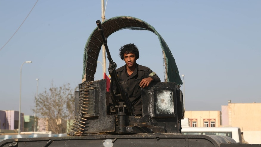 March 15, 2015 - A young volunteer militiaman on his way to the battlefield against Islamic State fighters in Tikrit, 80 miles north of Baghdad, Iraq. Kurdish forces in Iraq are investigating 2 other possible ISIS chemical weapons attacks, a top official said Monday, as authorities put an Iraqi offensive to retake Saddam Hussein's hometown on hold.