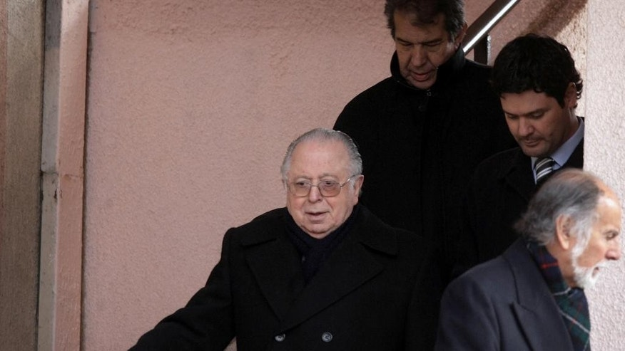 "In this July 18, 2011, Rev. Fernando Karadima leaves court after attending a hearing in connection with sexual molestation allegations against him in Santiago, Chile. Criminal charges against Karadima were dismissed in 2011 by Judge Jessica Gonzalez because the statute of limitations had expired, while a Vatican investigation found Karadima guilty in 2011 and sentenced the now 84-year-old priest to a cloistered life of ""penitence and prayer"" for what is Chile's highest-profile case of abuse by a priest. Karadima lives in isolation at a nun's convent and is barred from having contact with anyone outside of his own family. (AP Photo/La Tercera)"