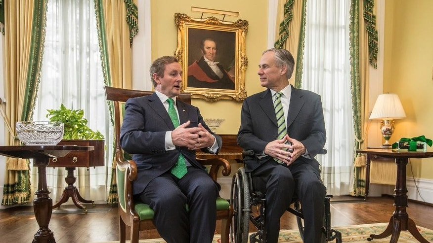 Texas Governor Greg Abbott, right, talks with Irish Prime Minister Enda Kenny at the Governor's Mansion in Austin, Texas, Sunday, March 15, 2015.  (AP Photo/Austin American-Statesman, Ricardo B. Brazziell)