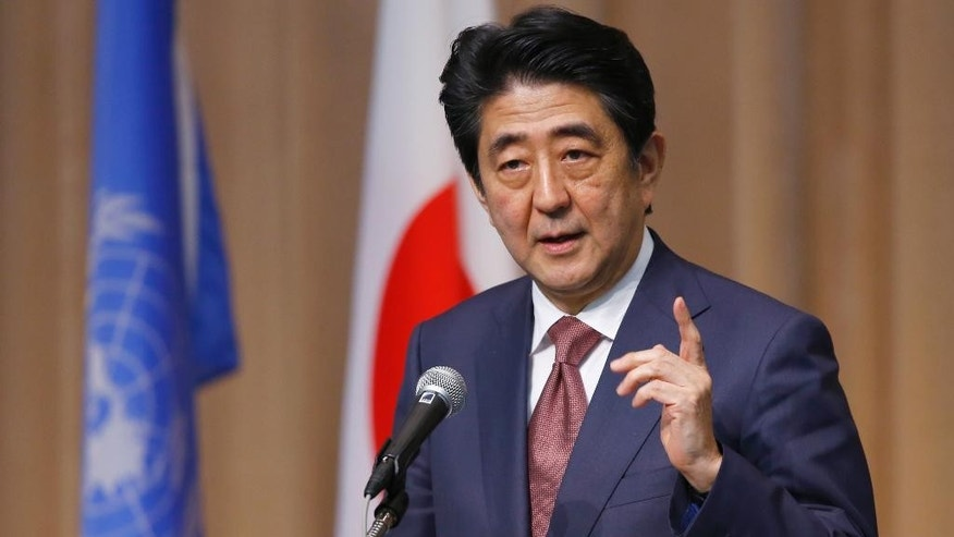 Japanese Prime Minister Shinzo Abe delivers a speech during a symposium of the 70th anniversary of the United Nations at the UN University in Tokyo, Monday, March 16, 2015. (AP Photo/Shizuo Kambayashi)