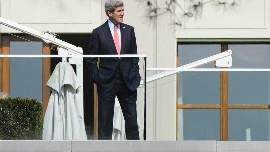 U.S. Secretary of State John Kerry takes a break during a bilateral meeting with Iranian Foreign Minister Mohammad Javad Zarif over Iran's nuclear program in Lausanne, Switzerland, Monday, March 16, 2015. The United States and Iran are plunging back into negotiations in an effort to end a decades-long standoff that has raised the specter of an Iranian nuclear arsenal, a new atomic arms race in the Middle East and even a U.S. or Israeli military intervention. (AP Photo/Keystone, Jean-Christophe Bott)