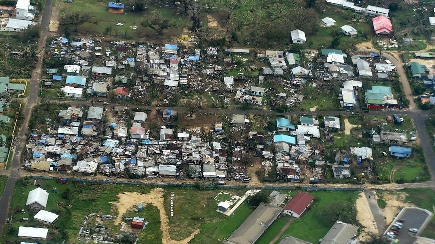 """Damage to houses in Port Vila, Vanuatu is seen from the air in the aftermath of Cyclone Pam Monday, March 16, 2015. Vanuatu's President Baldwin Lonsdale said Monday that the cyclone that hammered the tiny South Pacific archipelago over the weekend was a """"monster"""" that has destroyed or damaged 90 percent of the buildings in the capital and has forced the nation to start anew. (AP Photo/Dave Hunt, Pool)"""