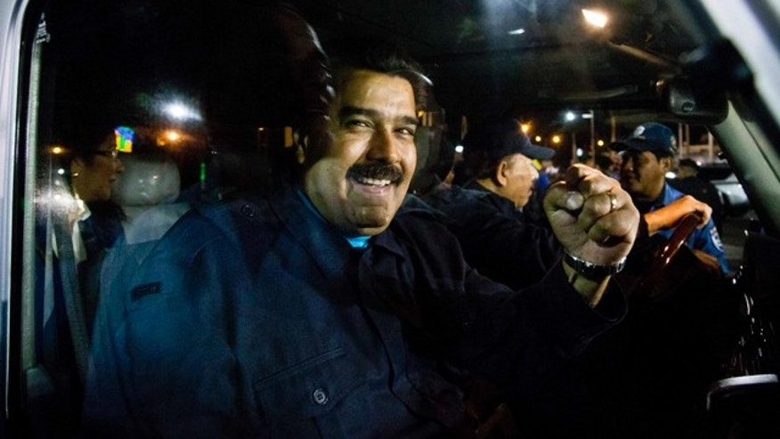 March 13, 2015: Venezuela's President Nicolas Maduro raises his fist from the passenger seat, as Nicaragua's President Daniel Ortega controls the steering of his vehicle, during a march organized to show solidarity with the South American country, in Managua, Nicaragua. (AP Photo/Esteban Felix)