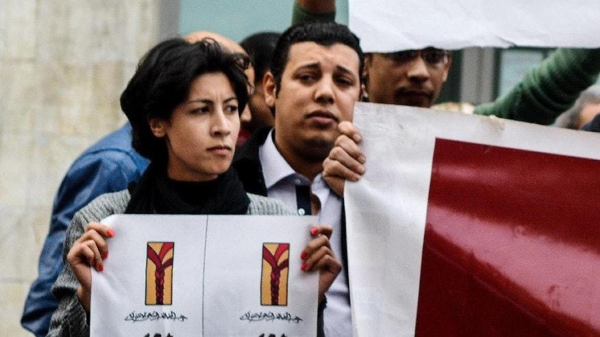 FILE - In this Saturday, Jan. 24, 2015 photo, 32-year-old mother Shaimaa el-Sabbagh holds a poster during a protest in downtown Cairo. Egypt's chief prosecutor has referred a police officer to trial for the deadly shooting of a female protester killed earlier this year during a peaceful demonstration. (AP Photo/Mohammed El-Raaei, File)