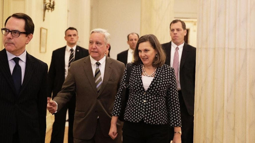 Assistant U.S. Secretary of State for European and Eurasian Affairs Victoria Nuland front, right, accompanied by  U.S. Ambassador to Greece, David D. Pearce, center, arrive for a meeting with Greek Foreign Minister Nikos Kotzias in Athens, on Tuesday, March 17, 2015. Nuland is on a 5-day trip to Europe. (AP Photo/Petros Giannakouris)