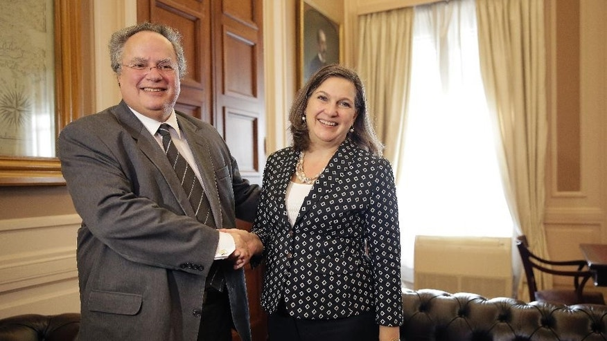Assistant U.S. Secretary of State for European and Eurasian Affairs Victoria Nuland, right, shakes hands with Greek Foreign Minister Nikos Kotzias during their meeting, in Athens, Tuesday, March 17, 2015. Nuland is on a 5-day trip to Europe. (AP Photo/Petros Giannakouris)