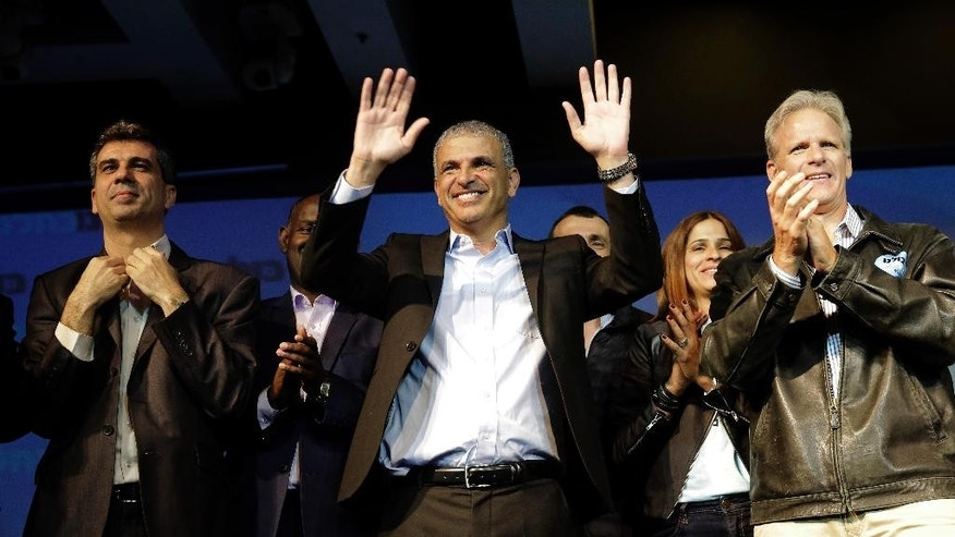 Moshe Kahlon, Kulanu party leader, greets his supporters  in the city of Tel Aviv, Wednesday, March 18, 2015. The upstart centrist Kulanu party has emerged as the kingmaker in the elections, and could tip the scale in favor of either Netanyahu or Zionist Union leader Isaac Herzog, as the two compete for a chance to form a coalition that commands a majority in the 120-member parliament. (AP Photo/Tsafrir Abayov)