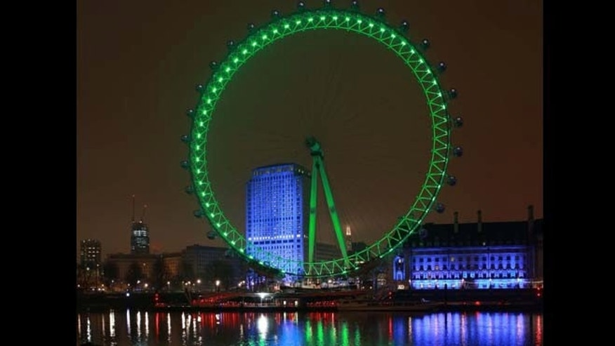 March 16, 2015: This image supplied by Tourism Ireland shows the London Eye floodlit green to celebrate St Patrick's Day on Tuesday. Landmark buildings across Ireland and the world have been floodlit green as global celebrations of the Emerald Isle's patron saint are culminating in parades and celebrations in Dublin and other cities, particularly in the U.S., on St. Patrick's Day.