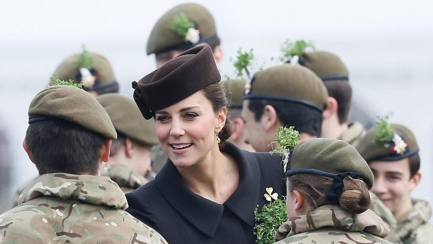 Britain's Kate, the Duchess of Cambridge meets cadets during a visit to the 1st Battalion Irish Guards at the St. Patrick's Day Parade at Mons Barracks, Aldershot, in England, Tuesday, March 17, 2015.  The Duke of Cambridge attended the Parade as Colonel of the Regiment and the Duchess of Cambridge presented the traditional sprigs of shamrocks to the Officers and Guardsmen of the Regiment. (AP Photo/Kirsty Wigglesworth)