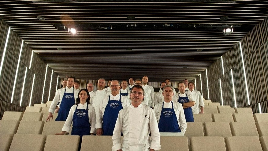 Twenty chefs from some of the world's best-rated restaurants, stand together for a photo during a meeting in San Sebastian, northern Spain, on Tuesday, March 17, 2015. They are trying to draw attention to what they hope is a simple solution to the threat facing many of the larger fish species that overfishing has pushed to near collapse. They say if more people ate more little fish - anchovies, sardines, herring and mackerel, for example - both human diets and seafood populations would improve. (AP Photo/Alvaro Barrientos)