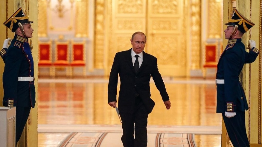Russian President Vladimir Putin enters a hall to attend a meeting of the V-Day celebrations organizing committee in the Kremlin in Moscow, Russia, Tuesday, March 17, 2015. (AP Photo/Sergei Ilnitsky, Pool)
