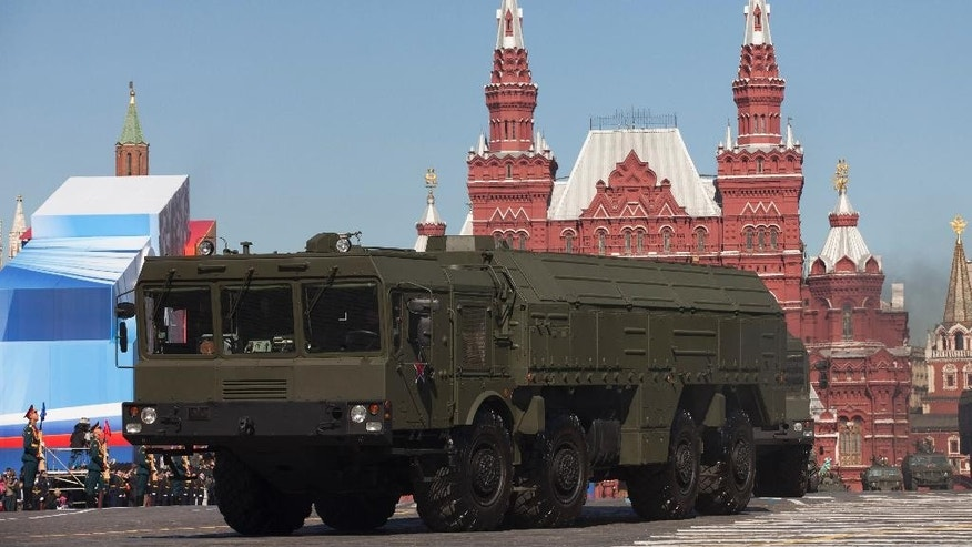 FILE - In this Tuesday, May 7, 2013 file photo, Russian Iskander missiles make their way through Red Square during a rehearsal for the Victory Day military parade in Moscow, Russia. Russia plans to station state-of-the art missiles to its westernmost Baltic exclave and deploy nuclear-capable bombers to Crimea as part of massive war games intended to showcase the nation's resurgent military power amid bitter tensions with the West over Ukraine. (AP Photo/Alexander Zemlianichenko, File)