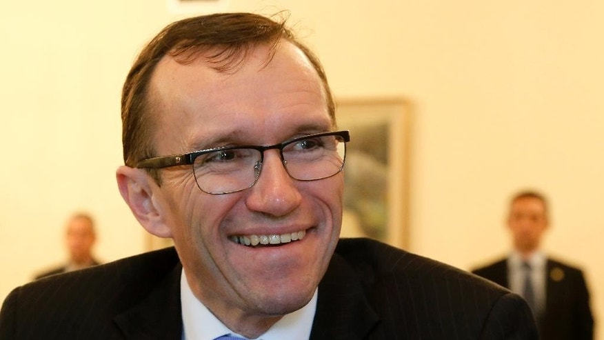 "United Nations envoy for Cyprus, Norway's Espen Barth Eide smiles during a meeting with Cyprus' president Nicos Anastasiades at the presidential palace in divided capital Nicosia, Tuesday, March 17, 2015. Eide said the reasons that led to a halt in talks may be over and that gas developments could create ""a climate where talks can continue."" (AP Photo/Petros Karadjias)"